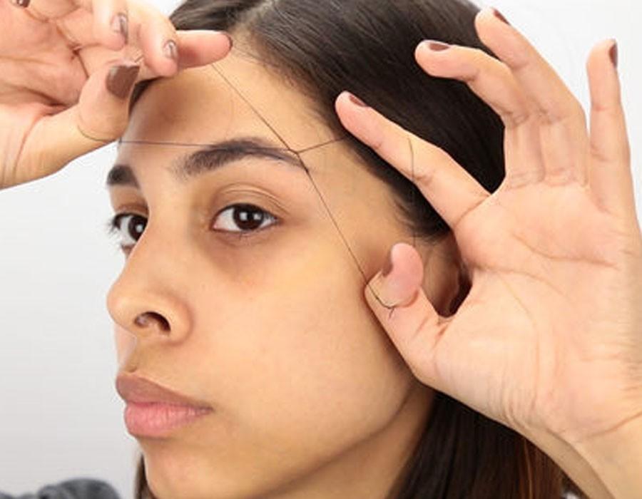 بالفيديو كيفية استخدام الفتلة لإزالة شعر الوجه بنفسك