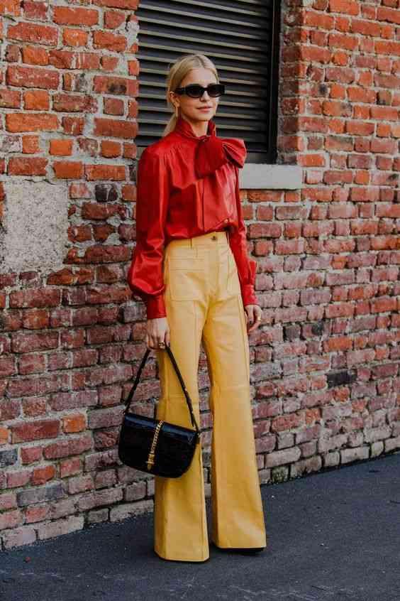 تنسيق اللون الأصفر مع الأحمر في الملابس