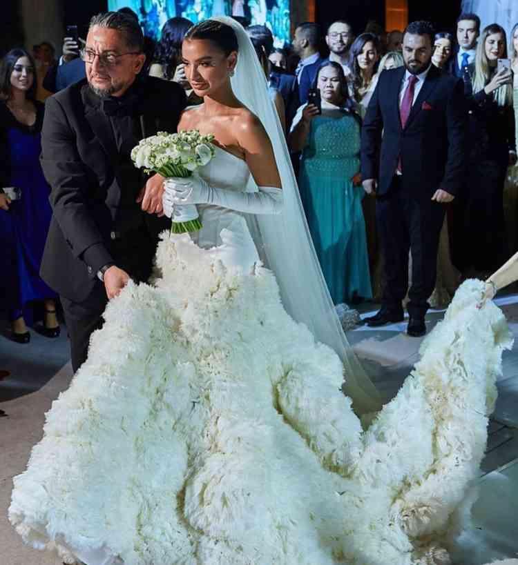 فستان زفاف رانيا فواز ابنة زينة زكي من تصميمها