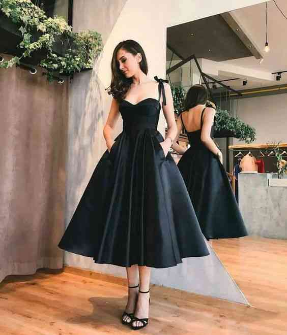 أنواع الفساتين فستان منفوش متوسط الطول أسود