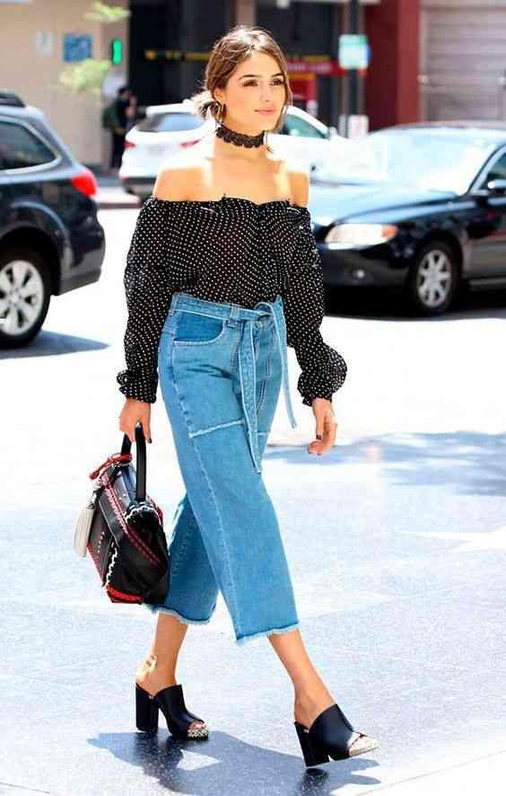 بنطلون واسع جينز مع بلوزة بأكتاف متساقطة