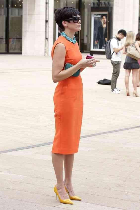 أنواع الفساتين فستان برتقالي